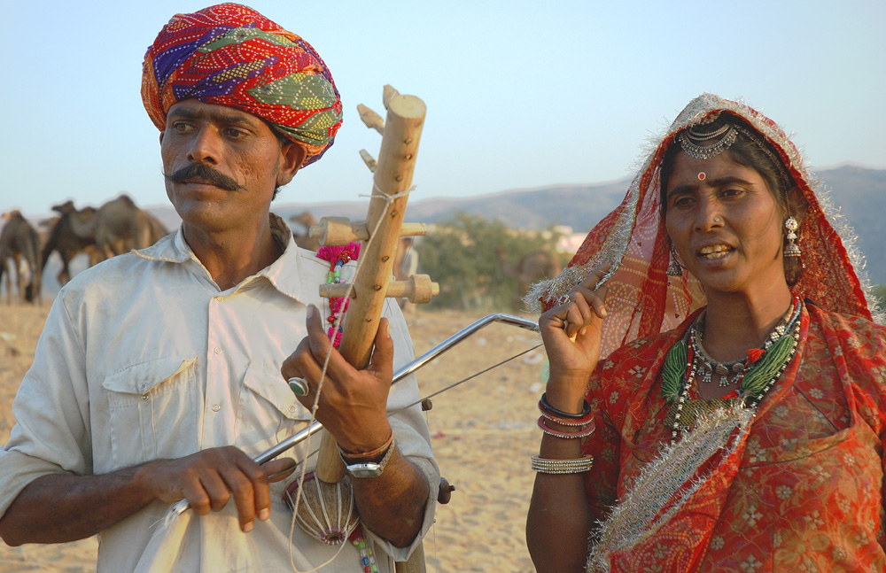 Indian folk musician couple at Pushkar Fair photograph by Raphael Shevelev