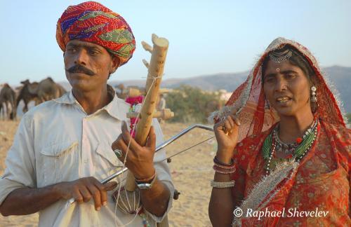 Indian folk musician couple at Pushkar Fair photograph by Raphael Shevelev